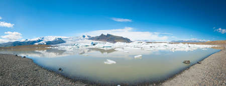 fjallsarlon: Beautiful panoramic photo of Fjallsarlon Glacial lake full of floating icebergs near the Fjallsjokull glacier