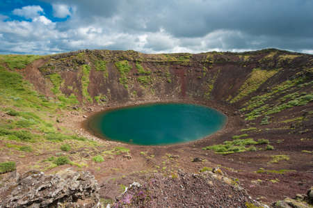 crater lake: Kerid is a beautiful crater lake of a turquoise color located on the South-West of Iceland. HDR