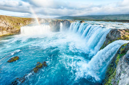 icelandic: Godafoss is a very beautiful Icelandic waterfall. It is located on the North of the island not far from the lake Myvatn and the Ring Road.