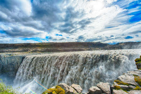 Dettifoss is the most powerful waterfall on Iceland and in the whole Europe. It is located in Jokulsargljufur National Park the northeasten Iceland on the river Jokulsa a Fjollum.  photo