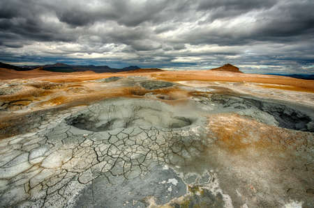 the stinking: Mudpots in the geothermal area Hverir, Iceland. The area around the boiling mud is multicolored and cracked. HDR image