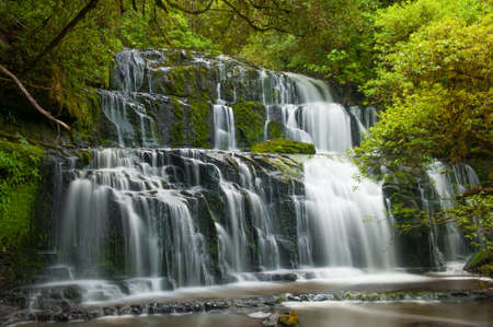 Purakaunui Falls is a beautiful small waterfall on the Catlins (South of the Southern island), New Zealand photo