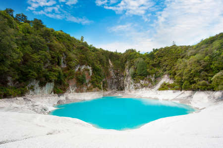 Incredibly blue and highly acidic Inferno Crater Lake at Waimangu geothermal area, New Zealand photo