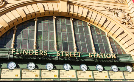 famous building: Flinders Street Station is a famous building from 1909 in Melbourne, Australia. Detail of the front gate with clocks