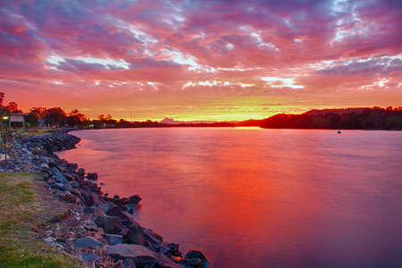 Wonderful sunset over the Tweed River at Chinderah with a Mt. Warning visible on horizon, New South Wales - Australia. HDR Stock Photo - 25631619