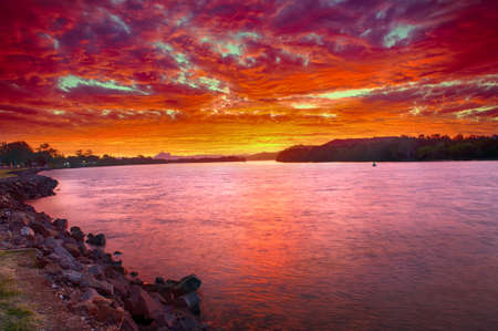 australia landscape: Wonderful sunset over the Tweed River at Chinderah with a Mt. Warning visible on horizon, New South Wales - Australia.