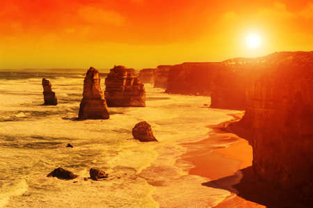 natural landmark: Twelve Apostles, natural landmark near the Great Ocean Road at dramatic sunset. Victoria, Australia