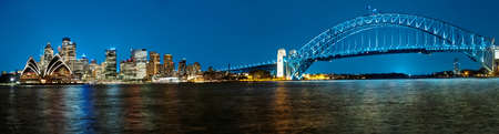 panoramic business: Panoramic photo of Sydney skyline with Harbour Bridge in the evening after sunset