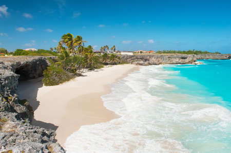 Bottom Bay is one of the most beautiful beaches on the Caribbean island of Barbados  It is a tropical paradise with palms hanging over turquoise sea and a pirate cave photo