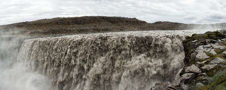 Dettifoss is the most powerful waterfall on Iceland and in the whole Europe. It is located in Jokulsargljufur National Park the northeasten Iceland on the river Jokulsa a Fjollum. Panorama photo