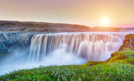 Dettifoss is the most powerful waterfall on Iceland and in the whole Europe. It is located in Jokulsargljufur National Park the northeasten Iceland on the river Jokulsa a Fjollum. Long exposure during the midnight sunset. photo