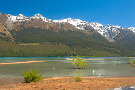 Beautiful lake Wakatipu with mighty mountains at Glenorchy. Otago region, New Zealand photo
