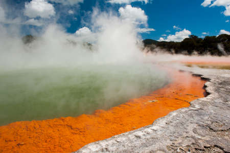 Unique steaming spring champagne pool in Wai-O-Tapu geothermal area, Rotorua, New Zealand photo