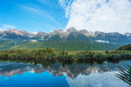 natural landmark: Mirror Lakes are a famous natural landmark omn the Milford Road in the Fiordland National Park. Snowy mountains are reflecting in a calm water. New Zealand Stock Photo