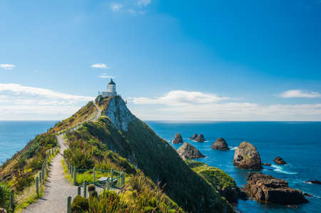 nugget: Lighthouse on Nugget Point. It is located in the Catlins area on the Southern Coast of New Zealand, Otago region. The Lighthouse is surrounded by small rock islands, nuggets