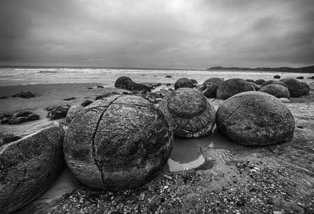 hdr: Moeraki Boulders on the Koekohe beach, Eastern coast of New Zealand. HDR image, black and white Stock Photo
