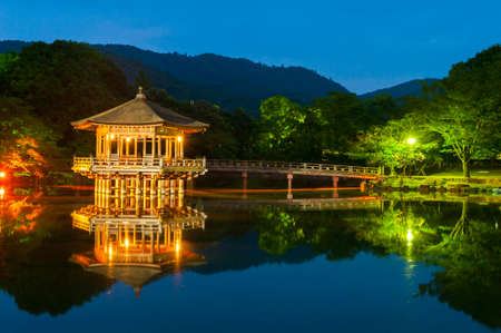 nara park: Nice japanese wooden gazebo is shortly after the sunset reflecting in the water. Nara, Japan.