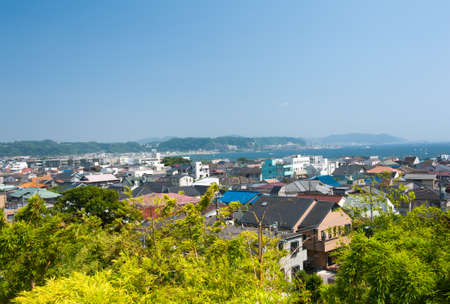 honshu: Houses near busy Yuigahama Beach at Kamakura, Honshu - Japan