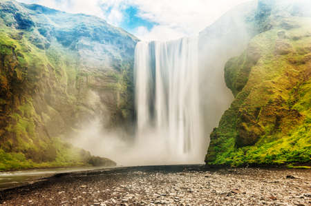skogafoss waterfall: Skogafoss is a well known Icelandic waterfall on the South of the Iceland near the town Skogar Stock Photo