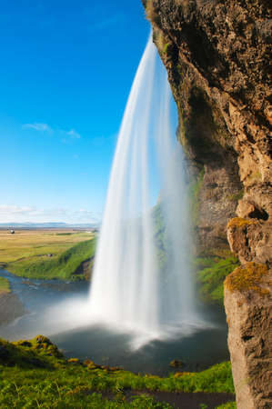 Seljalandsfoss is one of the most beautiful waterfalls on the Iceland. It is located on the South of the island.  photo