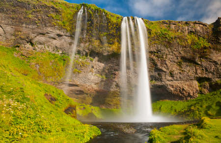 scandinavian landscape: Seljalandsfoss is one of the most beautiful waterfalls on the Iceland. It is located on the South of the island.  Stock Photo
