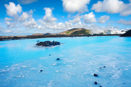 therapy geothermal: Blue water of the famous Icelandic Blue Lagoon spa is produced by near geothermal plant. The spa is located on Reykjanes peninsula not far from Keflavik airport and Reykjavik capital, Iceland.