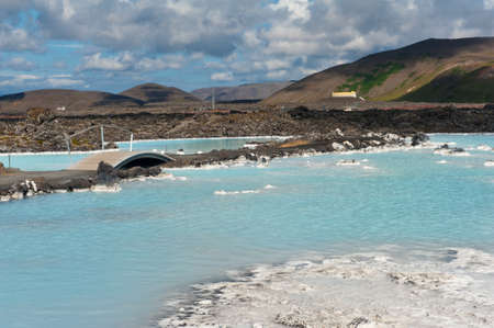 hot spring: Blue water of the famous Icelandic Blue Lagoon spa is produced by near geothermal plant. The spa is located on Reykjanes peninsula not far from Keflavik airport and Reykjavik capital, Iceland.