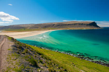 west coast: Extremly beautiful bay with mighty golden beaches and turquise sea in the West Fjords, Iceland.