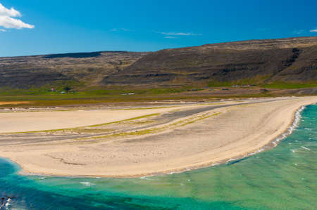 turquise: Extremly beautiful bay with mighty golden beaches and turquise sea in the West Fjords, Iceland. Panoramic photo Stock Photo