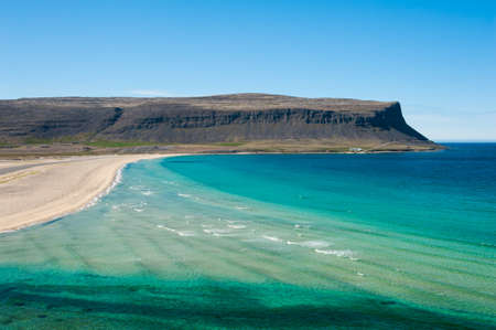 west coast: Extremly beautiful bay with mighty golden beaches and turquise sea in the West Fjords, Iceland. Panoramic photo Stock Photo