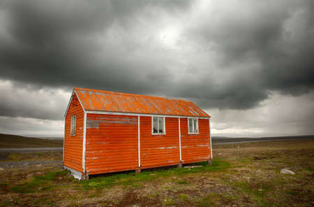 lodge: Old red snowstorm shelter can save a life in a cruel blizzard or in winter on Iceland