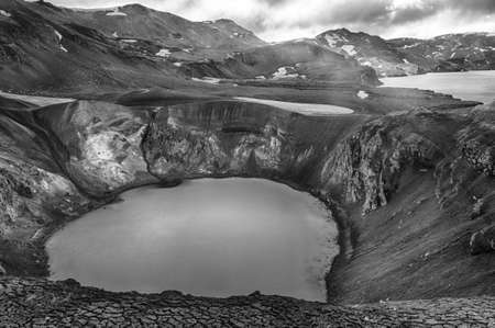 crater lake: Giant volcano Askja offers a view at two crater lakes. The smaller one is called Viti and contains warm geothermal water and is good for swimming. The large lake is Oskjuvatn, the second deepest lake on the Iceland. Black and white