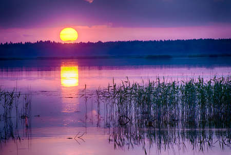 Beautiful vivid sunrise over the lake Kanieris, Latvia. HDR photo