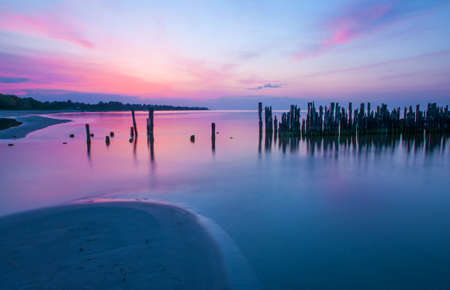 Old broken pier at sunset on the coast of the Baltic sea, Latvia photo