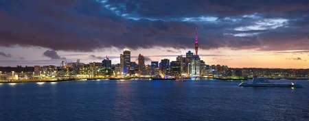 Skyline photo of the biggest city in the New Zealand, Auckland. Panoramic photo was taken after sunset across the bay photo