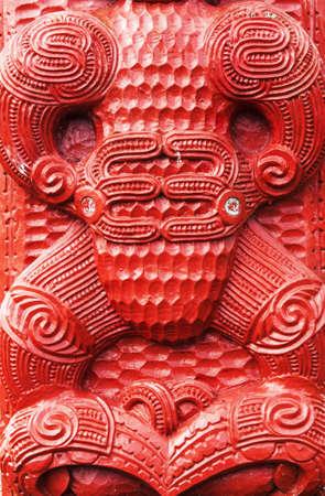 Detail of an old beautiful maori carving, Rotorua, New Zealand photo