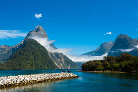 Famous Mitre Peak rising from the Milford Sound fiord. Fiordland national park, New Zealand photo