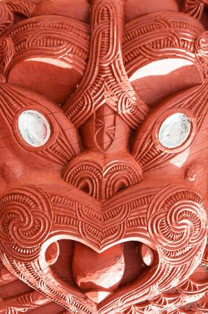 Beautiful maori carving. Detail of the historic meeting house Tamatekapua, Rotorua, New Zealand photo