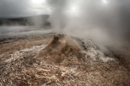 the stinking: Fumarole in the geothermal area Hveravellir, central Iceland. The area around is layered and cracked.