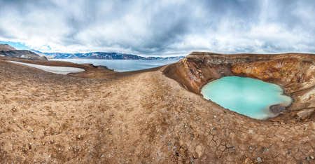 crater highlands: Giant volcano Askja offers a view at two crater lakes. The smaller, turquoise one is called Viti and contains warm geothermal water. The large lake is Oskjuvatn, the second deepest lake on the Iceland. Panorama