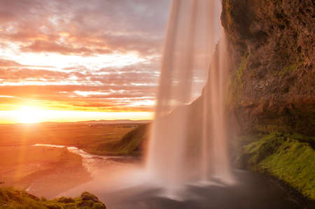 waterfall with sky: Seljalandsfoss is one of the most beautiful waterfalls on the Iceland. It is located on the South of the island.  Stock Photo