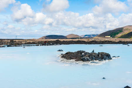 Blue water of the famous Icelandic Blue Lagoon spa is produced by near geothermal plant. The spa is located on Reykjanes peninsula not far from Keflavik airport and Reykjavik capital, Iceland.  photo