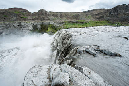 Hafragilsfoss is the very powerful waterfall on Iceland not far from its bigger brother Dettifoss. It is located in Jokulsargljufur National Park the northeasten Iceland on the river Jokulsa a Fjollum. photo