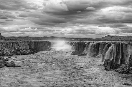 Selfoss is the very powerful waterfall on Iceland not far from its bigger brother Dettifoss. It is located in Jokulsargljufur National Park the northeasten Iceland on the river Jokulsa a Fjollum. photo
