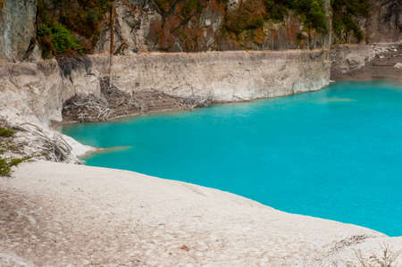 erupt: Incredibly blue and highly acidic Inferno Crater Lake at Waimangu geothermal area, New Zealand Stock Photo