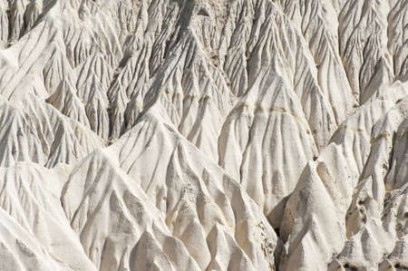 Detailed photo of white rock formations from above in Cappadocia, Turkey photo