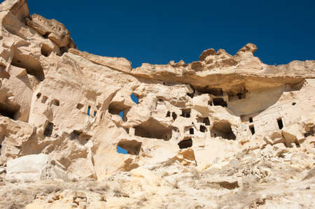 troglodyte: Detail of the ancient castle of Cavusin dug from a mountains, Cappadocia, Turkey