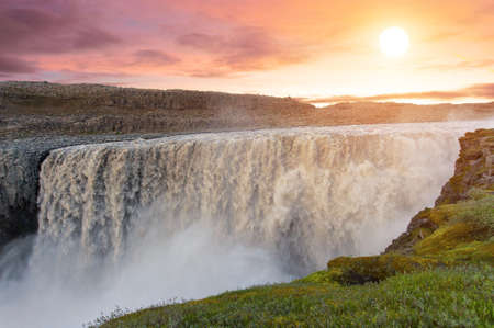 waterfall with sky: Sunset over, Dettifoss the most powerful waterfall on Iceland and in the whole Europe. It is located in Jokulsargljufur National Park the northeasten Iceland