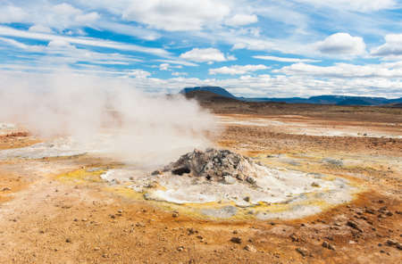 fumarole: Fumarole in the geothermal area Hverir, Iceland. The area around is multicolored and cracked. Stock Photo