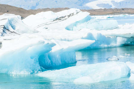 Detailed photo of the Icelandic glacier iceberg in a ice lagoon with incredibly vivid colors and a nice texture photo